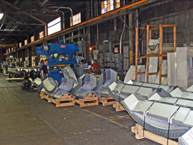 Prefabrykowane samonośne hale łukowe - produkcja hal łukowych TG Buildings, linia produkcyjna hal.