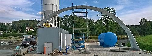 Samonośne hale łukowe - hala łukowa jako indywidualnie zaprojektowany prefabrykowany dach łukowy na kontenerze i konstrukcji HEB.