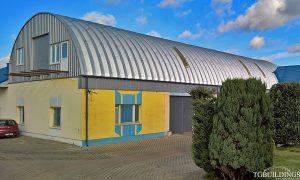 Samonośne hale łukowe - prefabrykowana stalowa hala łukowa jako lekki łukowy dach na posadowiony na miejscu płaskiego.
